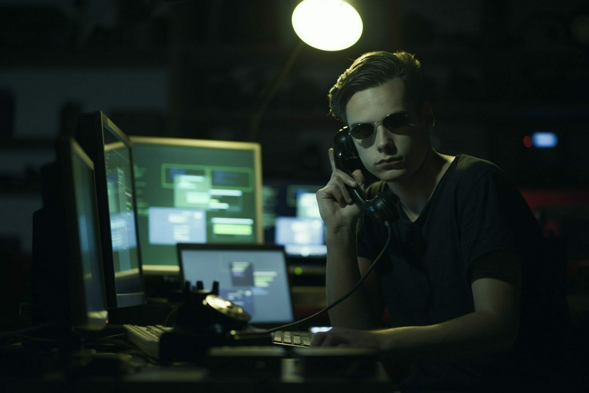 computer hacker making a phone call