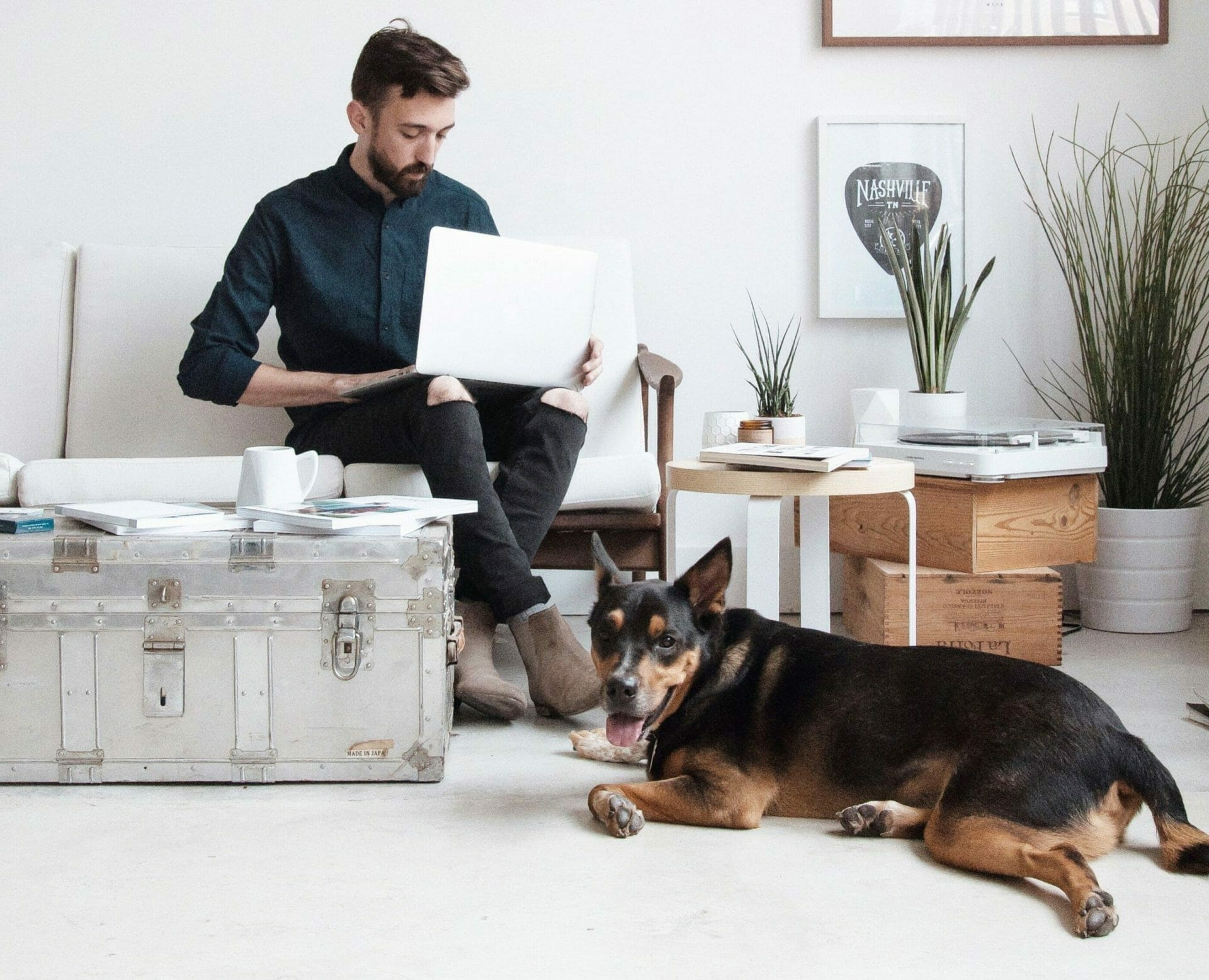 man working from home with dog