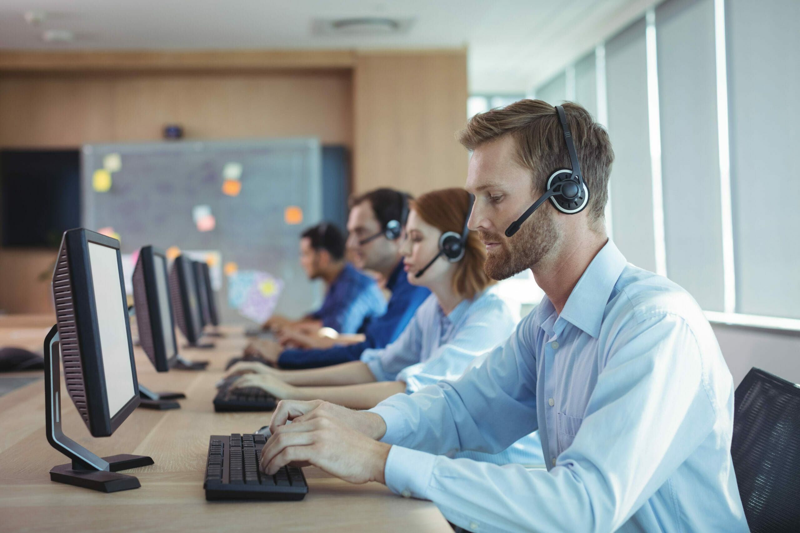 cloud contact center - Businessman typing on keyboard at call center