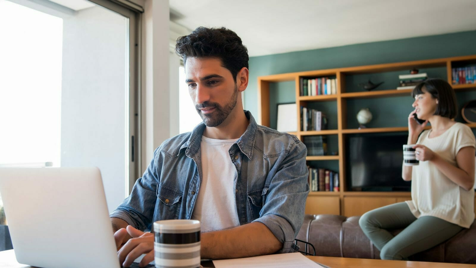 man using VoIP for a hybrid workplace